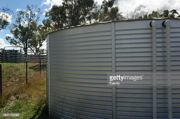 rain water catching and holding tank - storage tank stock photos and pictures