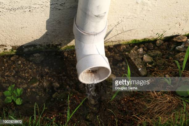 rain water in a down spout - heavy rain stock photos and pictures