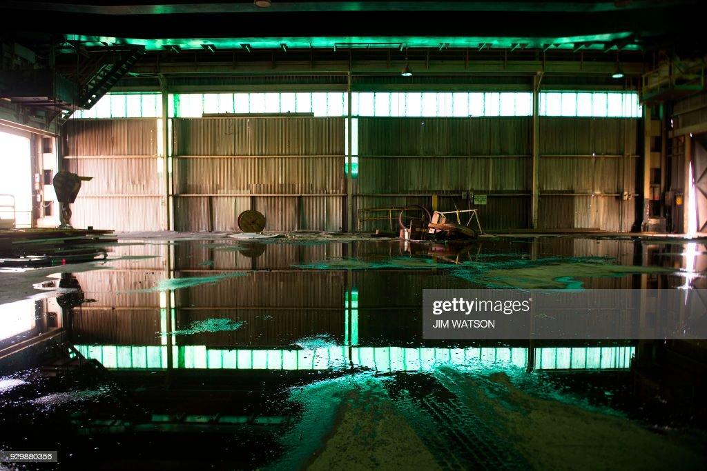 Rain water pools up in the empty Bethlehem Steel warehouse ...