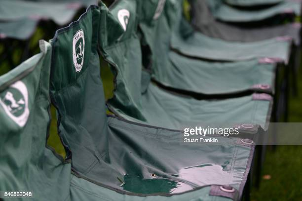 Rain water sits in sponsored spectator seats on the 18th hole during the delayed first round of The Evian Championship at Evian Resort Golf Club on...