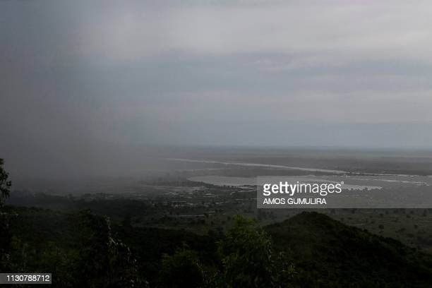 Rain, which is believed to be the beginning of Tropical cyclone Idai coming from central Mozambique, falls in the flooded districts of Chikwawa and...
