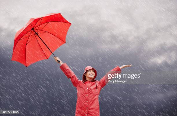 rain? who cares?! - umbrella stock pictures, royalty-free photos & images