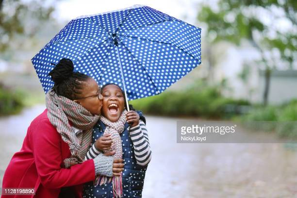 rain won't spoil our day - umbrella stock pictures, royalty-free photos & images