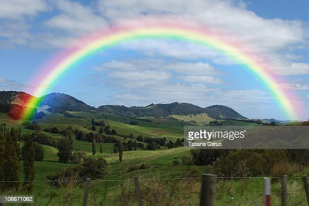 rainbow above the valley, new zealand - rainbow stock pictures, royalty-free photos & images