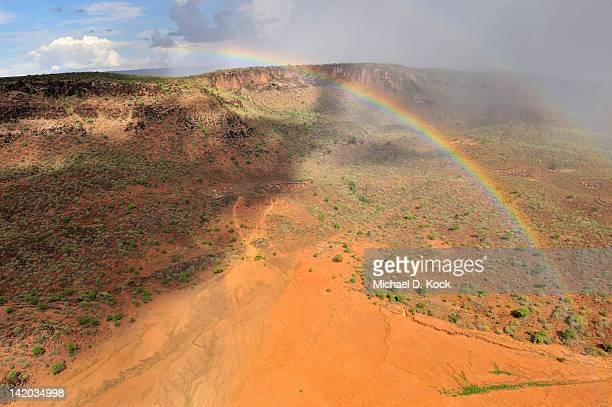 rainbow after the rains, taposa villages in kapoeta district, republic of south sudan - sudan stock pictures, royalty-free photos & images