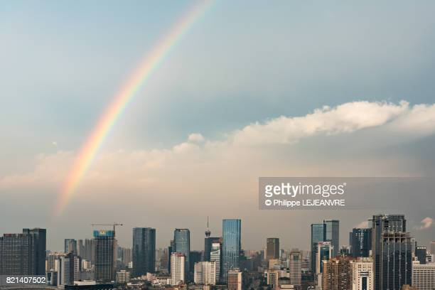 rainbow and clouds above chengdu city - 虹 ストックフォトと画像