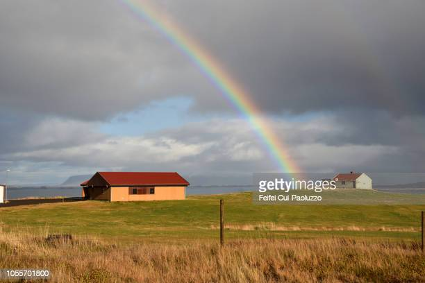 rainbow and farmhouse at alftafjordur in the westfjords of iceland - feifei cui paoluzzo stock pictures, royalty-free photos & images