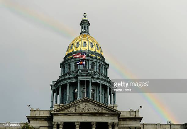 A rainbow appears after a brief rain October 18 2015 at the Colorado State Capitol Building Rain moved into the Denver metro area around 5pm and it...