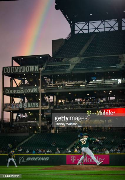 Rainbow appears as Brett Anderson of the Oakland Athletics delivers in the fifth inning against the Seattle Mariners at T-Mobile Park on May 14, 2019...