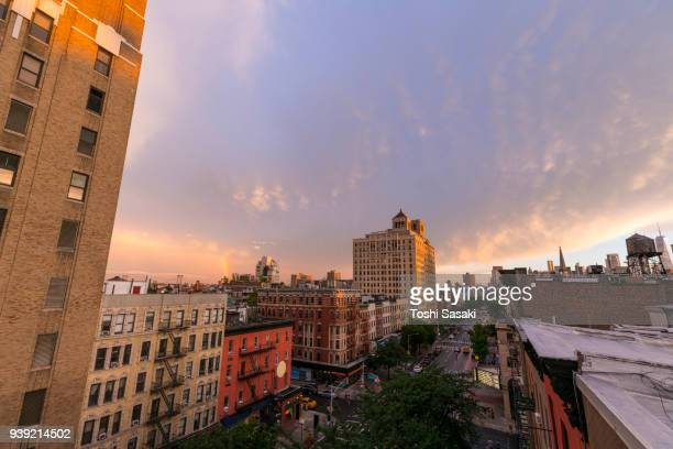 Rainbow appears behind the rows of buildings during the dusk at East Village Manhattan New York, NY, USA - July 01 2017.