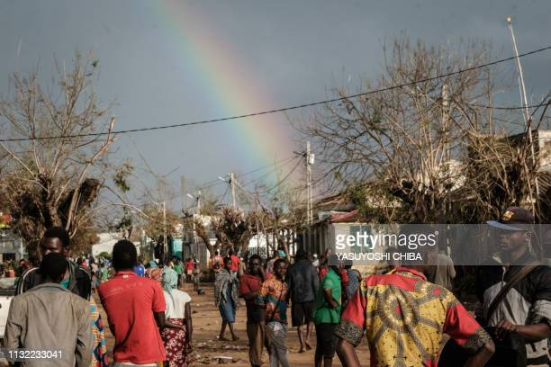 A rainbow appears in the sky in Buzi Mozambique on March 23 2019 The death toll in Mozambique on March 23 2019 climbed to 417 after a cyclone...
