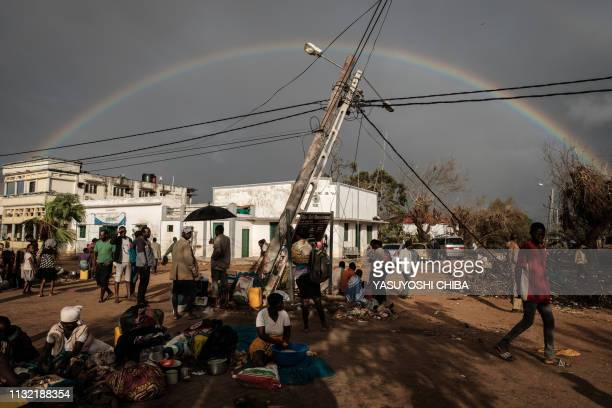 TOPSHOT A rainbow appears in the sky in Buzi Mozambique on March 23 after the area was hit by the Cyclone Idai The death toll in Mozambique on March...