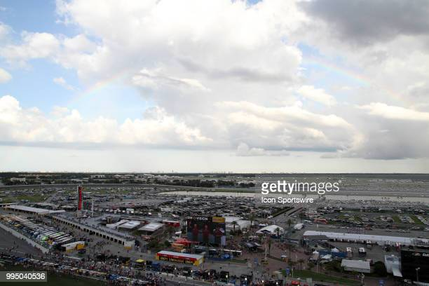 A rainbow appears just prior to the NASCAR Monster Energy Cup Series Coke Zero 400 in July 07 2018 at Daytona International Speedway in Daytona Beach...
