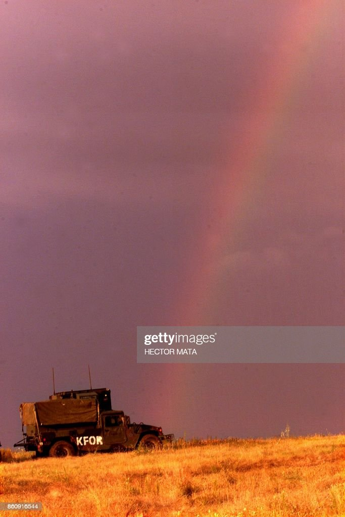 A rainbow appears on the sky at Camp Bondsteel south of