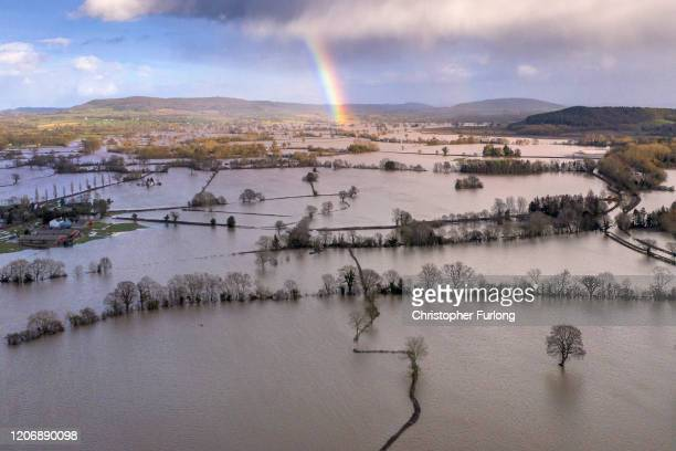 A rainbow appears over flooded fields in the Wye Valley near the hamlet of Wellesley following Storm Dennis on February 17 2020 in Hereford England...