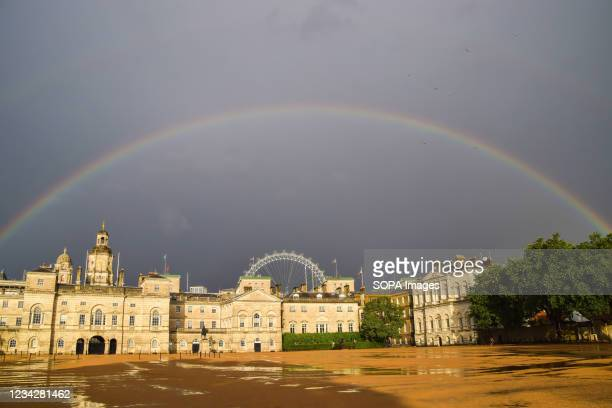 Rainbow appears over Horse Guards Parade ground after a day of heavy rain in London.