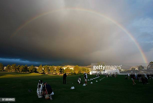 A rainbow appears over players warming up on the driving range before the start of play at the Justin Timberlake Shriners Hospitals for Children Open...