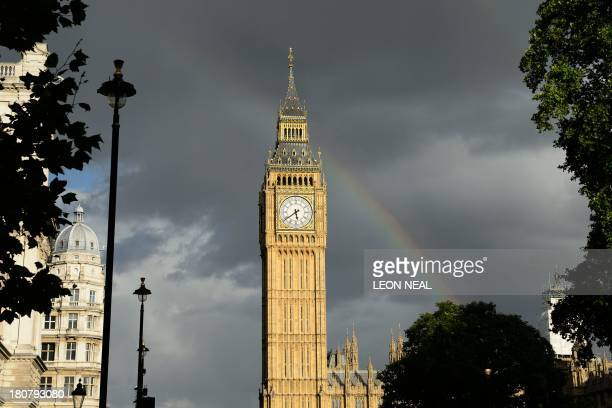 A rainbow appears over Saint Stephen's Tower widely mistakenly known as Big Ben in central London on September 16 2013 AFP PHOTO / LEON NEAL