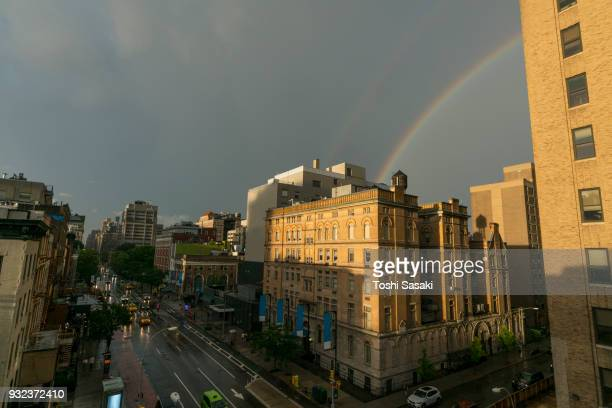 Rainbow appears over the East Village buildings during the dusk at Manhattan New York, NY, USA - July 01 2017.