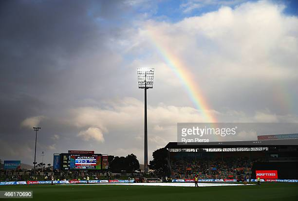 A rainbow appears over the ground during a rain delay during the 2015 Cricket World Cup match between Australia and Scotland at Bellerive Oval on...