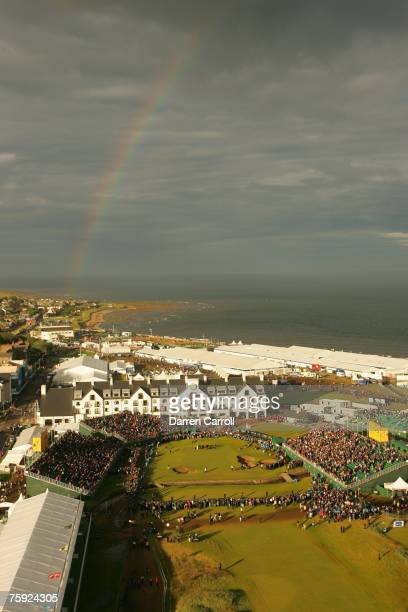 A rainbow appears over the town of Carnoustie in this aerial general view of the 18th green during the awards presentation for the 136th Open...