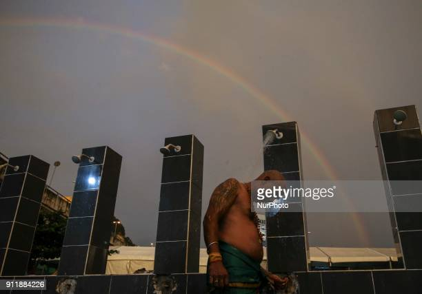 A rainbow are seen during indian devotee take shower before making their praying for the upcoming Thaipusam day at Batu Cave Kuala Lumpur on 29...