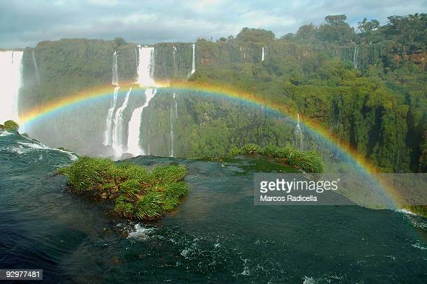 rainbow at iguazu falls - radicella stock photos and pictures