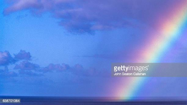 rainbow at sunset beach - image title stock pictures, royalty-free photos & images