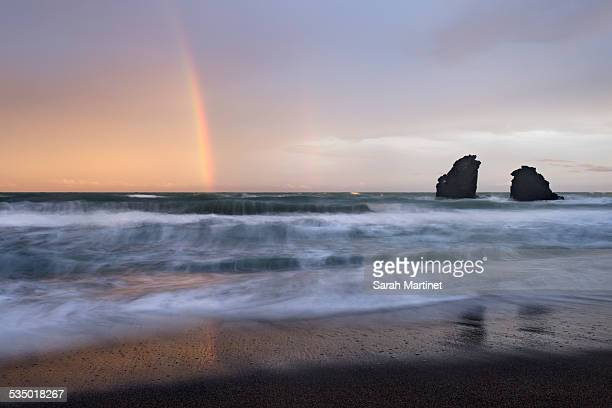 rainbow at sunset on a beach - cap d'agde stock photos and pictures