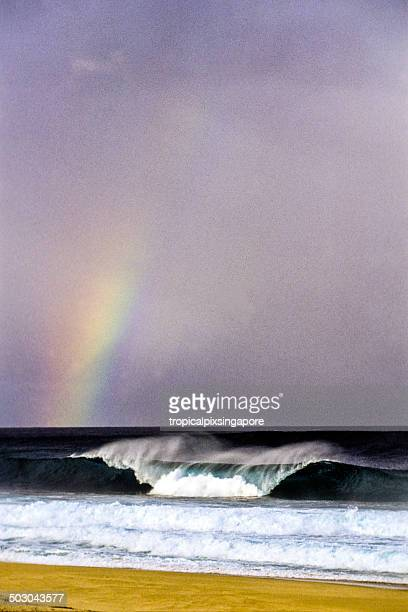 rainbow at the banzai pipeline - banzai pipeline stock photos and pictures