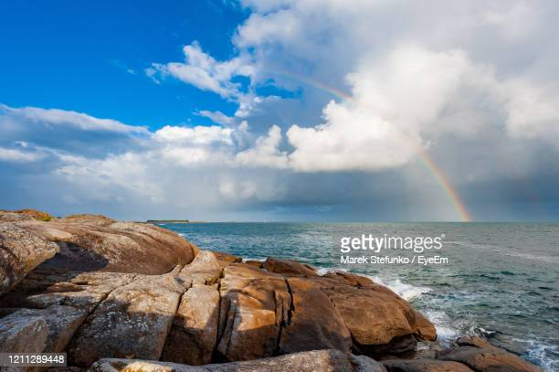 rainbow at the coast of quiberon peninsula in brittany - marek stefunko stock pictures, royalty-free photos & images