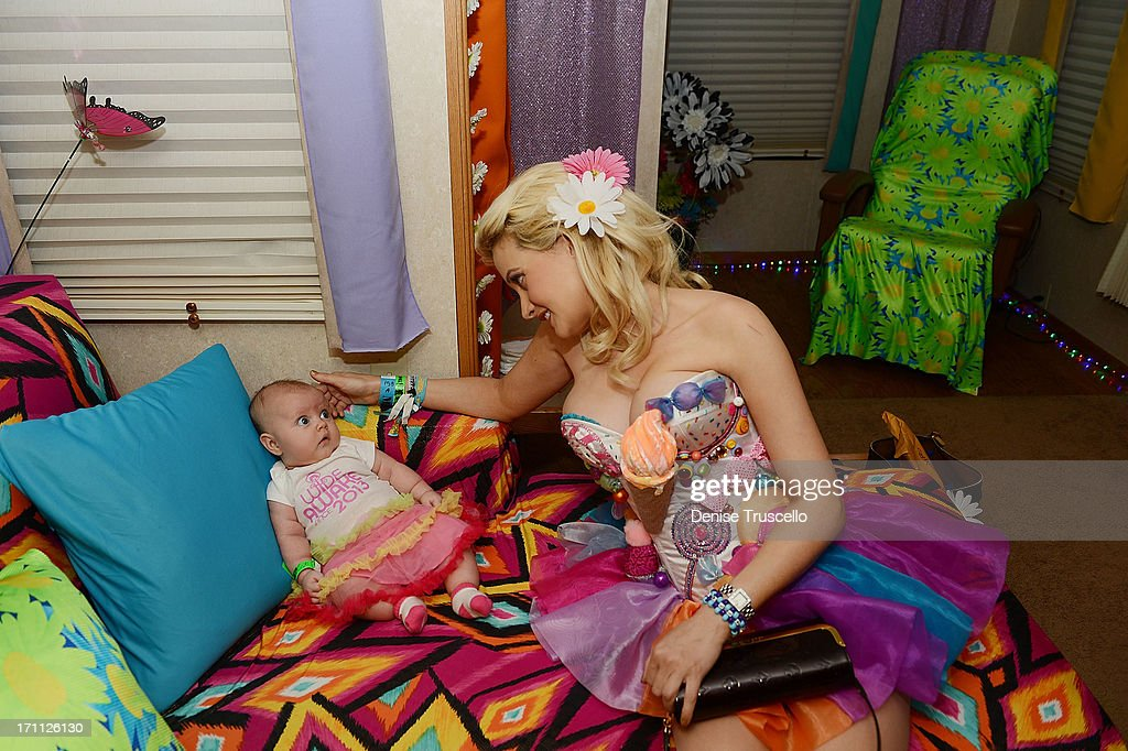 Rainbow Aurora Rotella and Holly Madison pose for a portrait in a quiet room before the 17th annual Electric Daisy Carnival at Las Vegas Motor Speedway on June 21, 2013 in Las Vegas, Nevada.