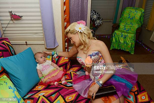 Rainbow Aurora Rotella and Holly Madison pose for a portrait in a quiet room before the 17th annual Electric Daisy Carnival at Las Vegas Motor...