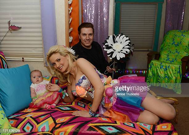 Rainbow Aurora Rotella Holly Madison and Pasquale Rotella pose for a portrait in a quiet room before the 17th annual Electric Daisy Carnival at Las...
