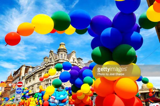 rainbow balloons of the pride parade in brighton uk - brighton england stock pictures, royalty-free photos & images