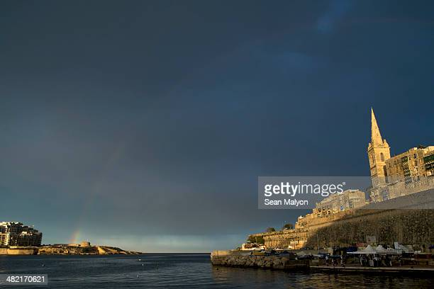 rainbow between valletta and sliema, malta - sean malyon stock pictures, royalty-free photos & images