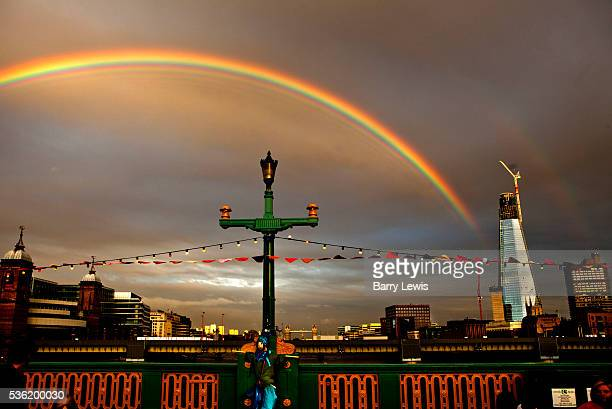 Rainbow breaks out over Southwark Bridge which is transformed into a giant banqueting space, designed by Cathy Wren, with visitors invited to share a...