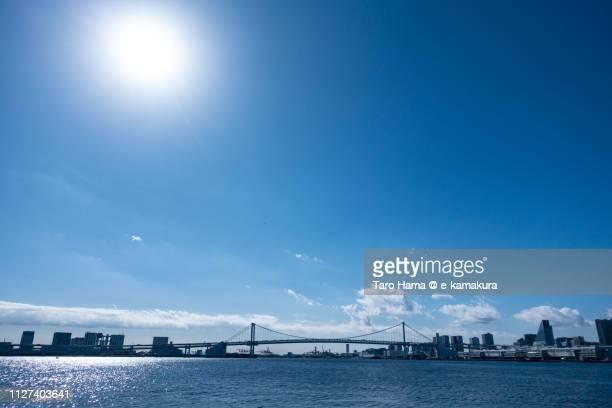 rainbow bridge and odaiba in tokyo in japan - sunlight ストックフォトと画像