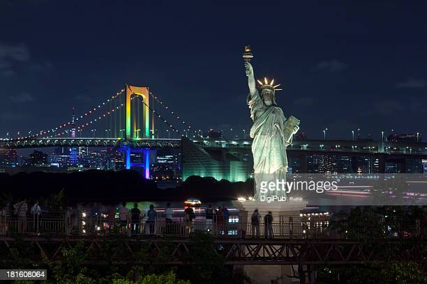 Rainbow Bridge and statue of liberty on Tokyo Bay