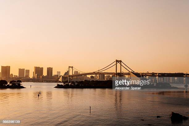 Rainbow bridge and Tokyo skyline at sunset, Japan