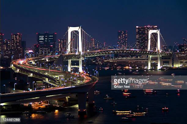 rainbow bridge at night in tokyo - nee nee stock photos and pictures
