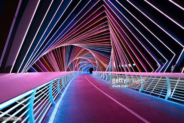 rainbow bridge at night - futuristic stock pictures, royalty-free photos & images