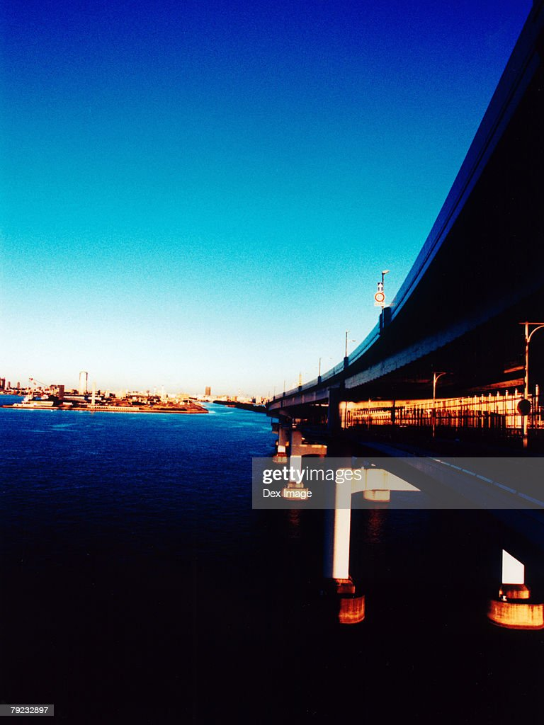 Rainbow Bridge at sunset, Tokyo Bay, Tokyo, Japan : Stock Photo