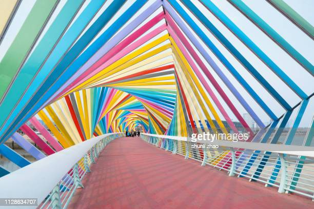 rainbow bridge, qingdao city - bright colour stock pictures, royalty-free photos & images