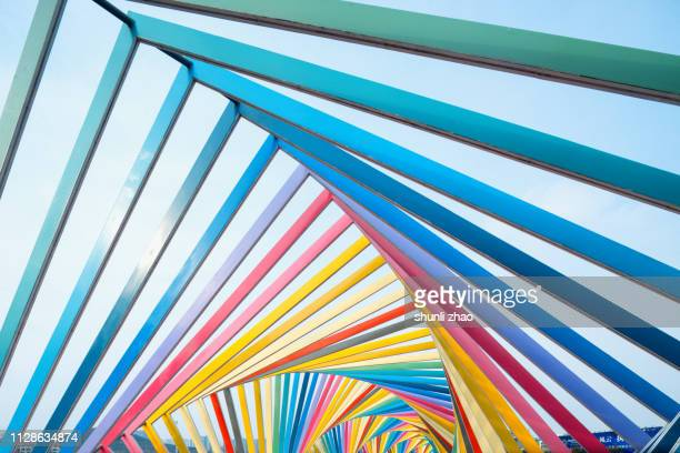 rainbow bridge, qingdao city - qingdao beach stock pictures, royalty-free photos & images