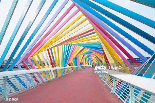 rainbow bridge, qingdao city - qingdao stock pictures, royalty-free photos & images