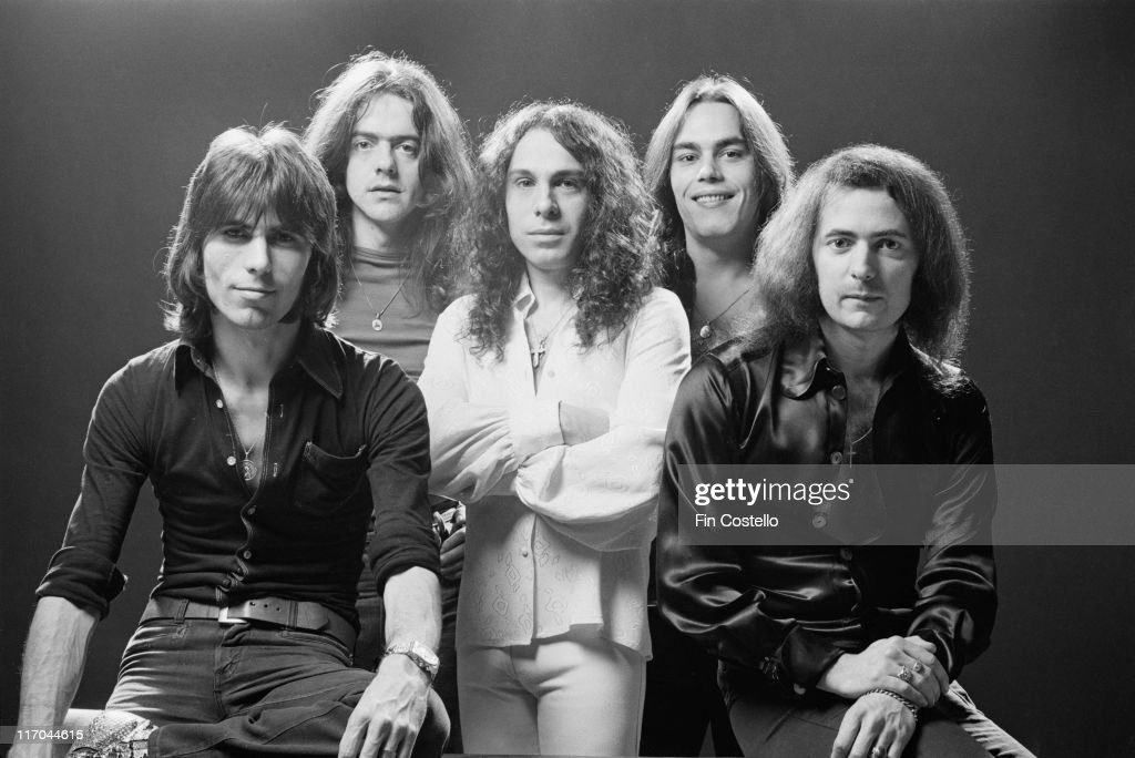 Rainbow (drummer Cozy Powell (1947-1998), singer Ronnie James Dio (1942-2010), keyboard player Tony Carey, bassist Jimmy Bain and guitarist Ritchie Blackmore), British rock band, pose for a group studio portrait for use on the cover of the band's album, 'Rising', in 1976.