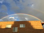 rainbow over apartment building
