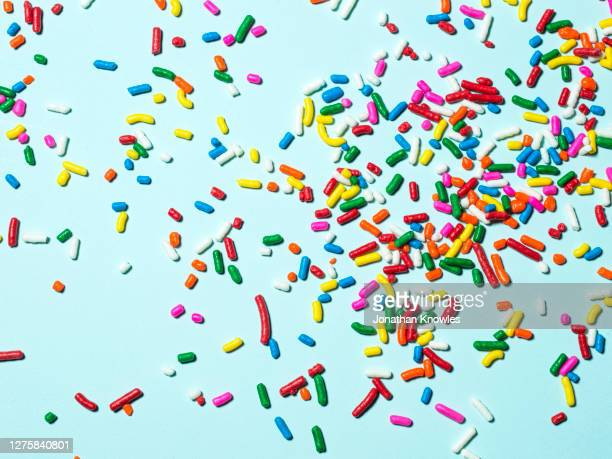 rainbow candy sprinkles - sugar sprinkles stock pictures, royalty-free photos & images
