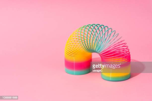 rainbow coil toy - bright colour stock pictures, royalty-free photos & images